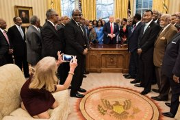 Counselor to the President Kellyanne Conway takes a photo as US President Donald Trump and leaders of historically black universities and colleges talk before a group photo in the Oval Office of the White House before a meeting with US Vice President Mike Pence February 27, 2017 in Washington, DC. / AFP / Brendan Smialowski (Photo credit should read BRENDAN SMIALOWSKI/AFP/Getty Images)